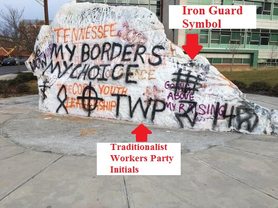 picture of rock in knoxville with graffiti on it that read my border my choice and twp and includes the cross symbol